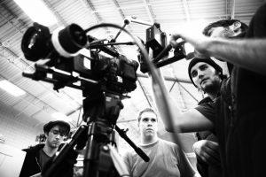 Film crew around camera.